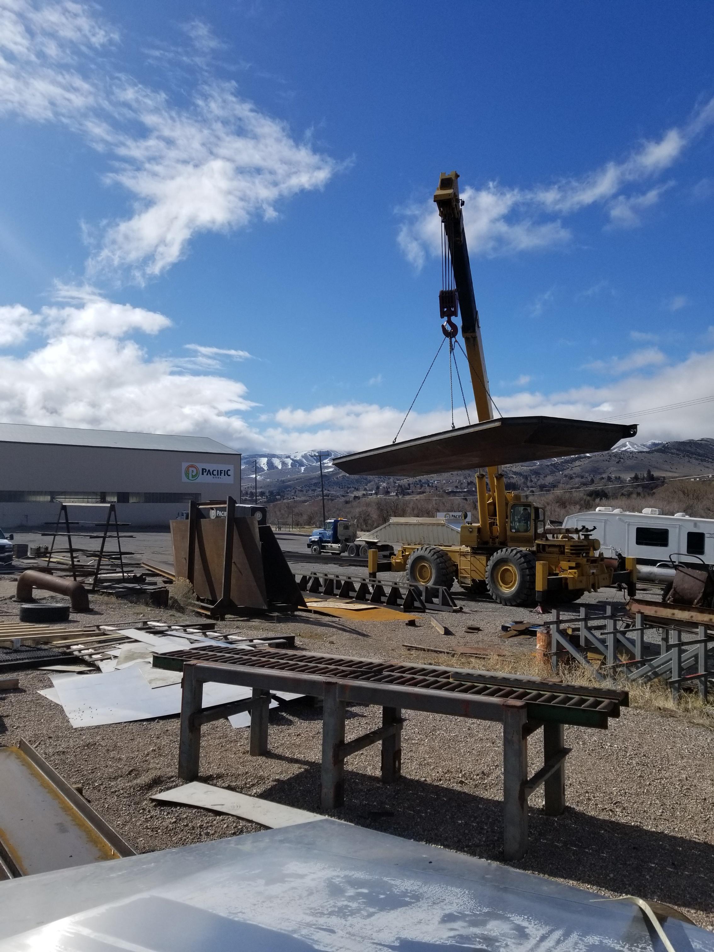 crane carrying metal