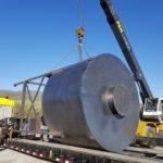 crane loading metal piece